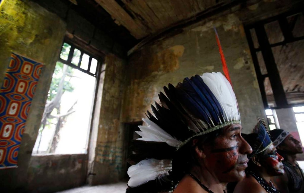 Native Indian men attend a news conference at the Brazilian Indian Museum in Rio de Janeiro