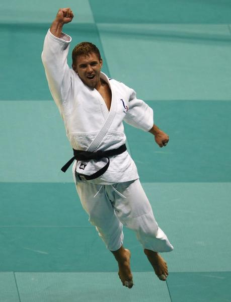 Loie Pietri of France celebrates his victory against Avtandili Tchrikishvili of Georgia during their men's under 81kg final match at the 2013 Judo World Championships match in Rio de Janeiro