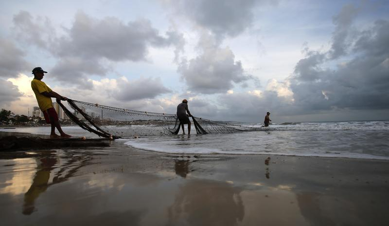 Fishermen work at Ponta Negra beach in Natal