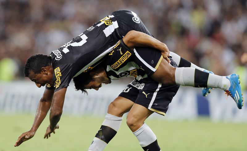 Henrique of Brazil's Botafogo celebrates with teammate Elias after scoring his goal against Ecuador's Deportivo Quito during their Copa Libertadores qualifying soccer match in Rio de Janeiro